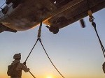 Marines with the 26th MEU Perform Lift at Sunset on Beach