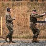 Marine Corps Combat Shooting Team Members Coach Shooting Competition
