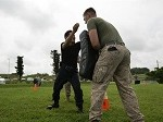 Japanese Security Guards Complete Nonlethal Weapons, OC Spray Training