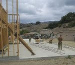 Leaders Tour Seabee-Built Mock City For Training Search Dogs